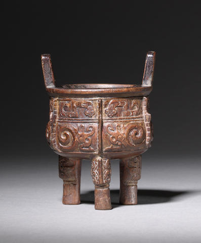 A chenxiangmu archaistic tripod incense burner, ding Late Qing Dynasty