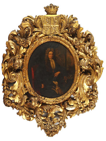 English School, 18th Century Portrait of a gentleman, three-quarter-length, seated with a dog in a carved giltwood frame