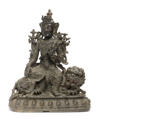 A bronze figure of Manjusri on a Buddhist lion 16th century