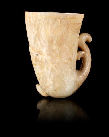 A pale green jade rhyton cup Ming Dynasty