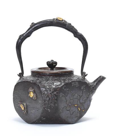 An inlaid rounded square tetsubin (iron teapot) By Ryubundo, mid/late 19th century