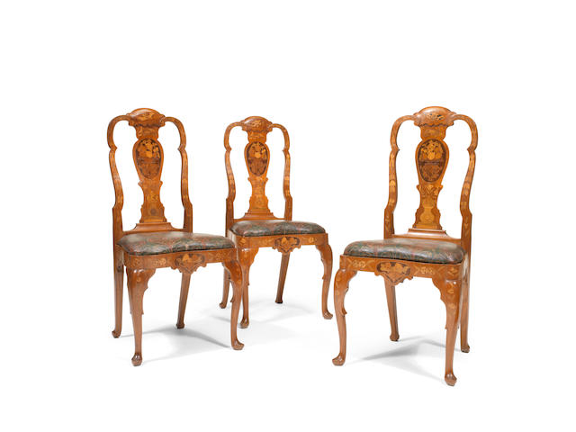 A set of twelve late 18th/early 19th century Dutch mahogany and fruitwood marquetry dining chairs