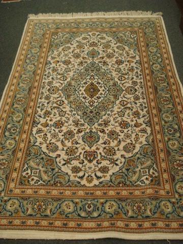 A Kashan rug, 1.65 x 1.26.