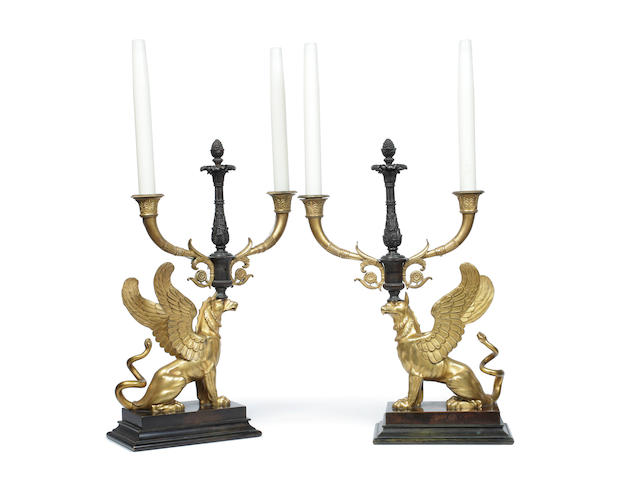 A pair of Empire ormolu and bronze twin branch candelabra