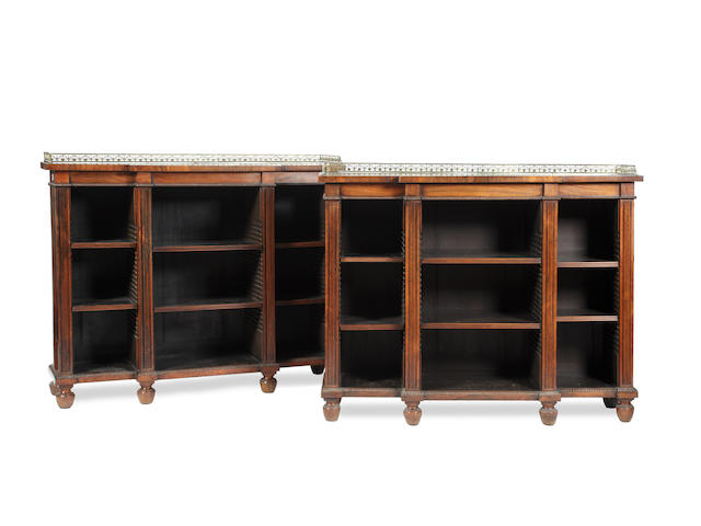 A pair of 19th Century rosewood breakfronted open bookcases