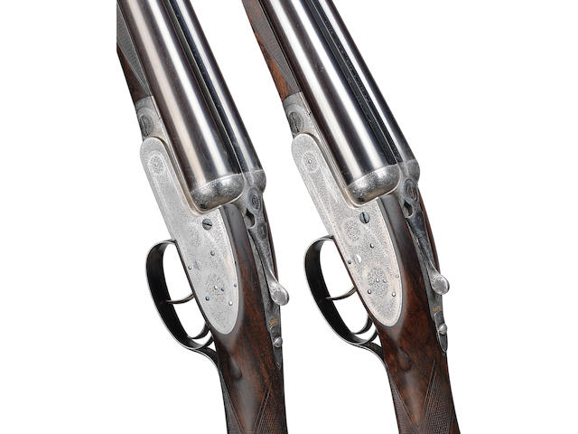 A pair of 12-bore self-opening sidelock ejector guns by J. Purdey & Sons, no. 20542/3 In their brass-mounted oak and leather case with a later canvas cover