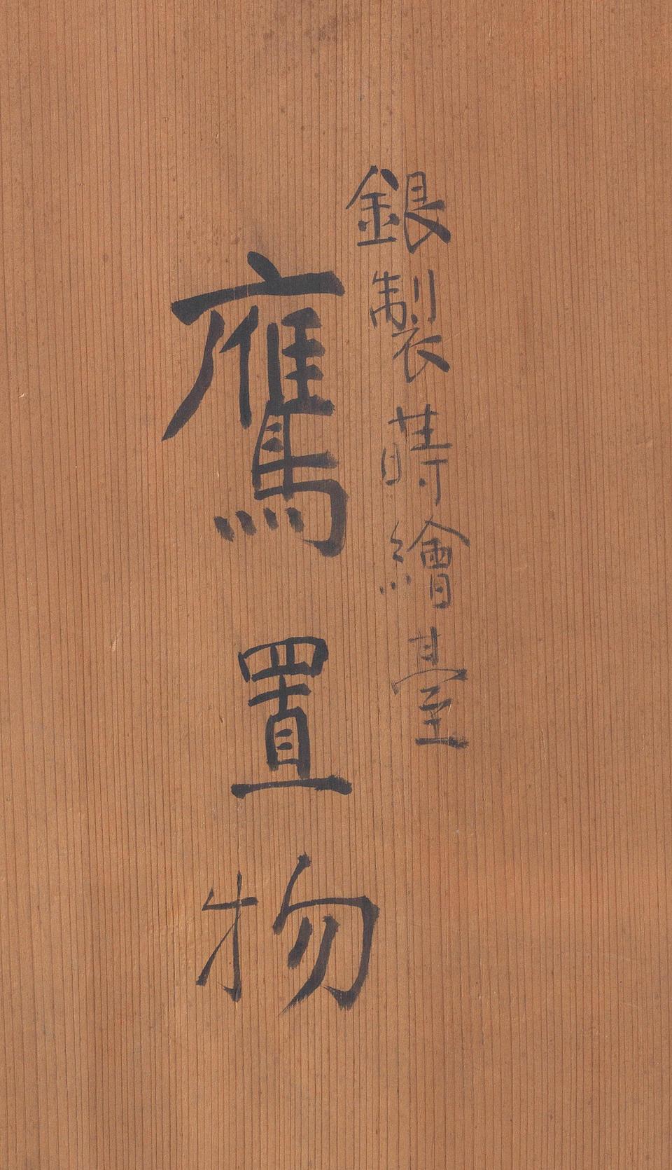 A silver okimono of a hawk on a black lacquer tall perch for the tokonoma (tea-room alcove) The hawk by Shoami Yoshihiro, the lacquer perch by Kanshosai Toyo II, Meiji Period