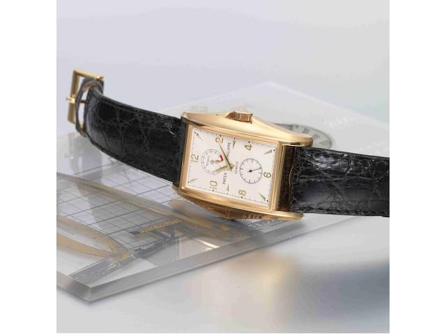 Patek Philippe. A very fine and rare limited edition 18ct gold flared rectangular cased manual wind wristwatch with box and papers Ref.5100J 'Manta Ray', Case No.4123812, Movement No.3203037, Retailed by Tiffany & Co. 17th March 2001