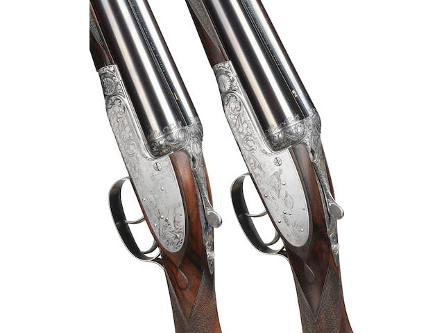 A fine pair of K.C. Hunt-engraved 12-bore self-opening sidelock ejector guns by J. Purdey & Sons, no. 27511/2 In their leather motor-case with canvas cover