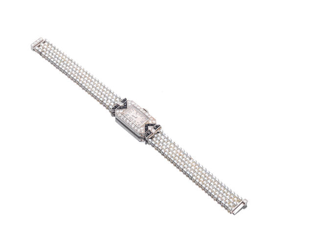 An art deco pearl, diamond and onyx watch, by Van Cleef & Arpels,