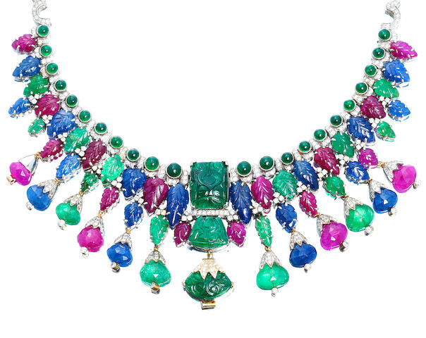 A multi gem-set necklace and earclip suite,