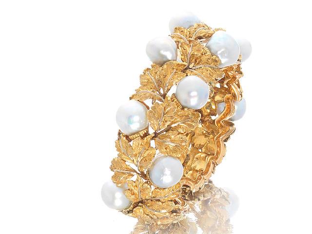 A cultured pearl torque bangle, by Buccellati,
