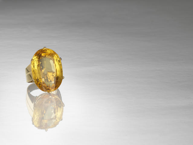 A yellow sapphire single-stone ring,