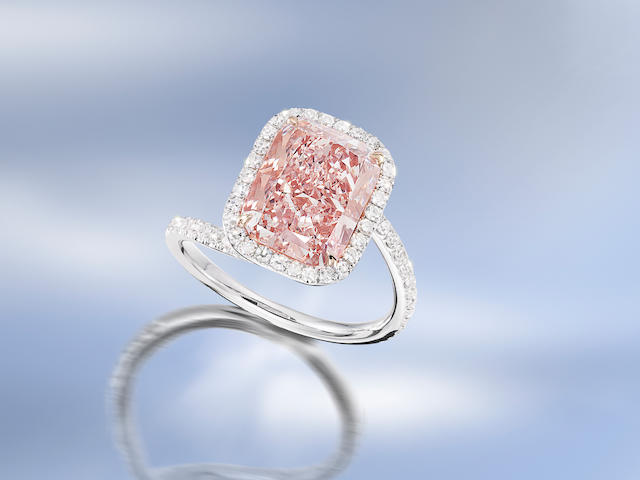 An exceptional fancy coloured diamond and diamond ring,  by Kwiat