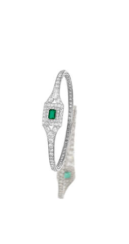 A fine early 20th century emerald and diamond bangle, by Cartier,