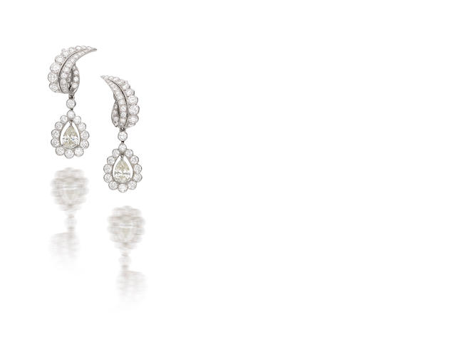 A pair of diamond pendent earrings, by Cartier,
