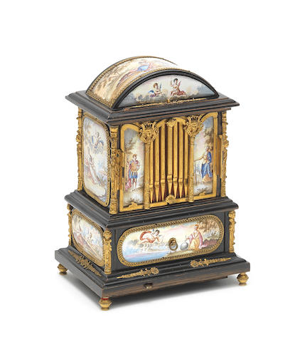 A late 19th/early 20th century Viennese enamelled, gilt metal and ebonised musical table cabinet