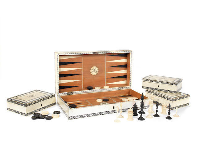 A mid 19th century Vizagapatam ivory and horn inlaid folding chess and backgammon board