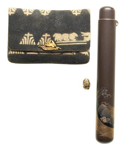 A lacquer kiseruzutsu with tabako-ire  The kiseruzutsu by Takai Taisai (dates unknown), the tabako-ire with a kanagu by Kano Natsuo (1828-1898), Meiji Period