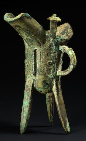 A fine archaic bronze tripod pouring vessel, jue Shang Dynasty