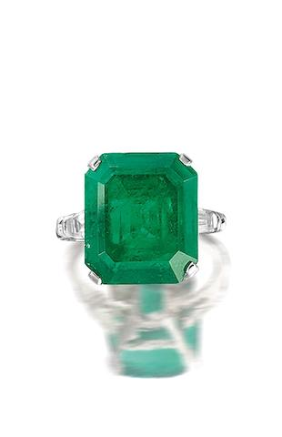 An emerald diamond ring