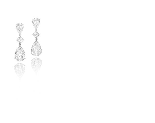 A fine pair of diamond pendent earrings, by Harry Winston