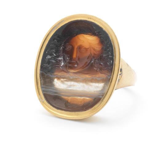 An 18th-19th century banded agate intaglio of Medusa