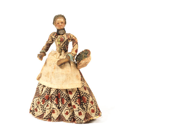 A rare and early poured wax miniature lady doll, English circa 1730