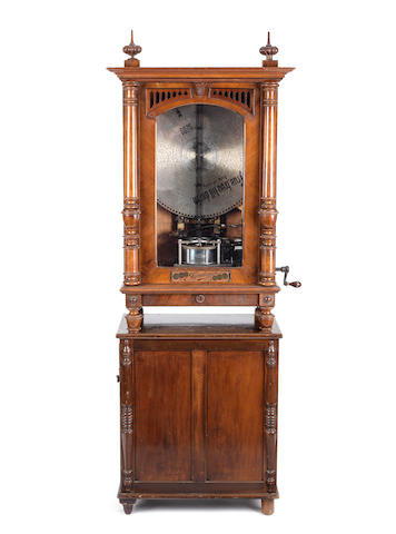 A 19 1/8-inch Symphonion disc musical box on stand, German, circa 1900,