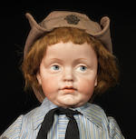 An extremely rare Kämmer & Reinhardt 106 'Heinz' bisque head character doll