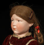 A unique and previously unknown bisque head character doll marked 11, probably by Kämmer & Reinhardt