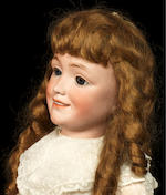 A rare Simon & Halbig 1388 bisque head smiling character doll