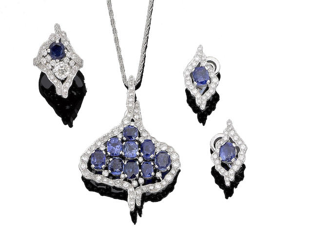 A sapphire and diamond pendant, ring and earrings suite, by Geoffrey Turk (3)
