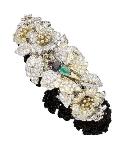 A gem-set and diamond floral bangle