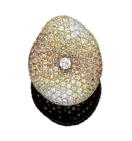 An orange and yellow sapphire and diamond dress ring