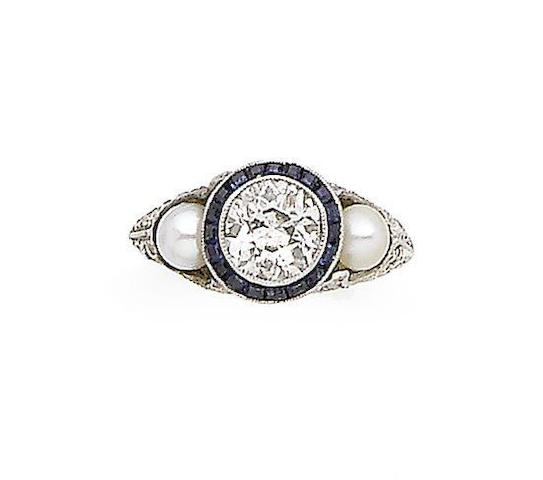 A cultured pearl, sapphire and diamond dress ring