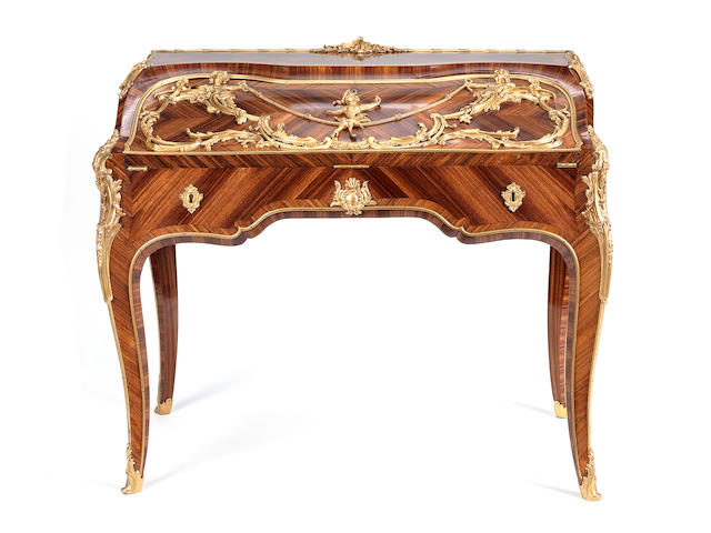A French late 19th century Louis XV style ormolu-mounted kingwood, satiné and tulipwood bureau à dos d'âne
