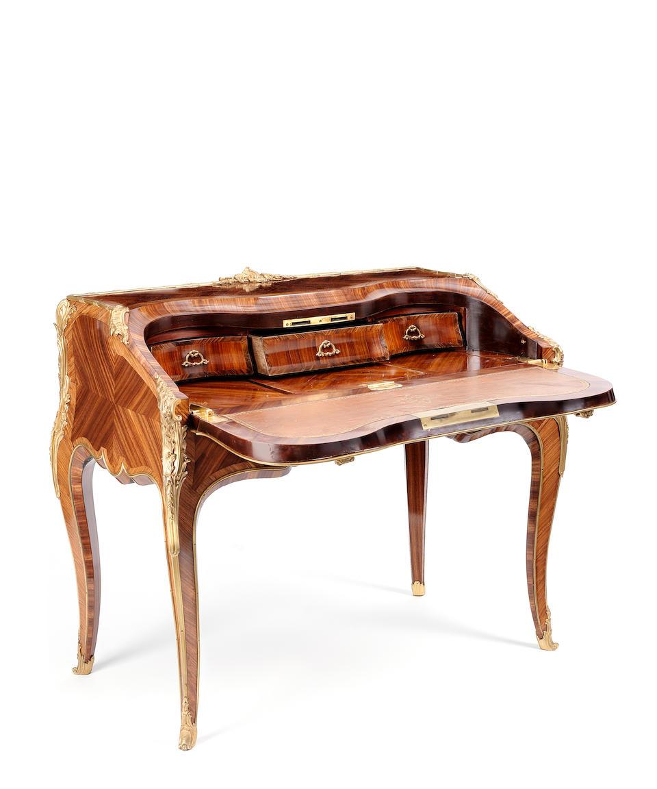 A French late 19th century Louis XV style ormolu-mounted kingwood, satiné and tulipwood bureau à dos d'âne