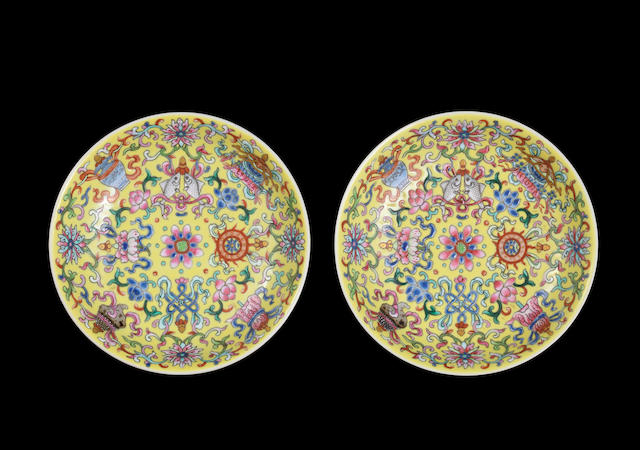 A pair of famille rose yellow-ground 'bajixiang' dishes Jiaqing seal marks and of the period
