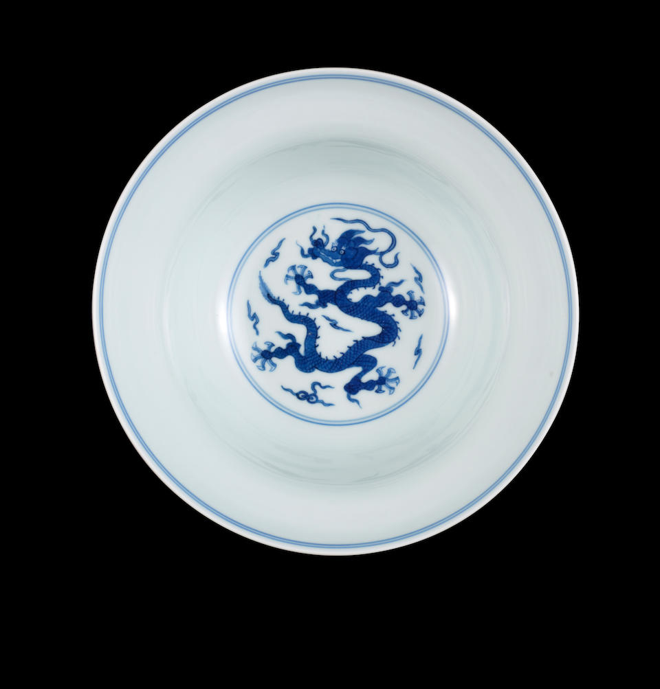 A pair of blue and white ogee-shaped 'dragon' bowls Qianlong seal marks and of the period