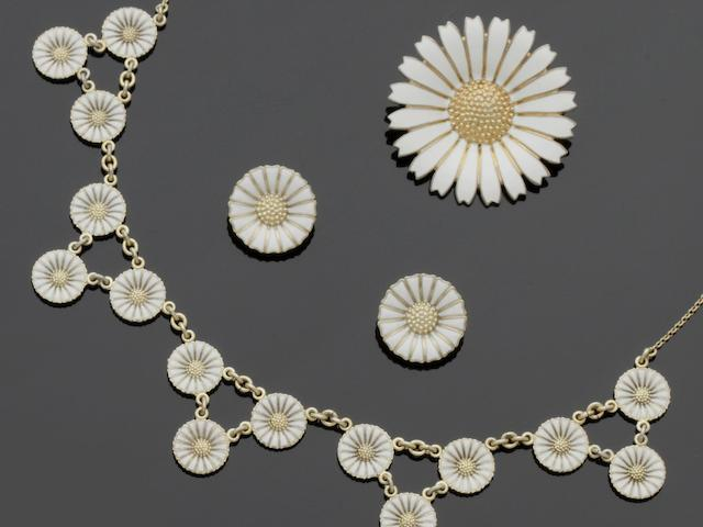 Anton Michelsen: A silver-gilt and white enamel 'Marguerite' necklace and earclips suite (3)