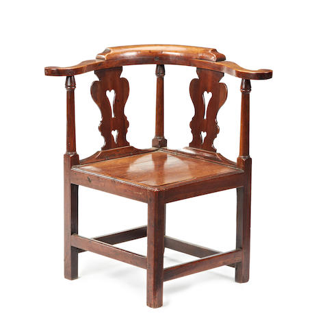 An early George III fruitwood corner armchair
