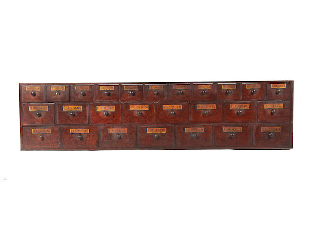 Two sections of Victorian mahogany chemist or pharmacy drawers