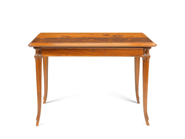 A French Art Nouveau rosewood, tulipwood, bois satiné and marquetry side table by Emile Gallé
