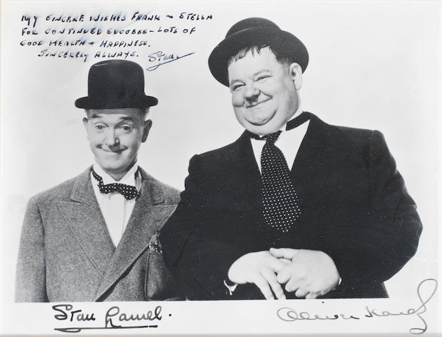 Laurel & Hardy: A publicity photograph signed and inscribed by Stan Laurel,