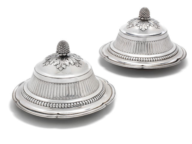 Catherine the Great: An important pair of Louis XVI silver circular dish covers (cloches) and dishes from the Ekaterinoslav and Moscow Services covers by Robert-Joseph Auguste, Paris 1782-83, dishes by Louis-Joseph Lenhendrick, Paris 1777-78 (4)