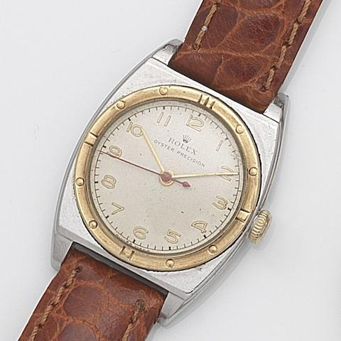 Rolex. A stainless steel and gilt manual wind wristwatch Oyster Precision, Ref:3359, Serial No.375***, Circa 1945