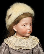 An extremely rare Kämmer & Reinhardt 103 bisque head character doll
