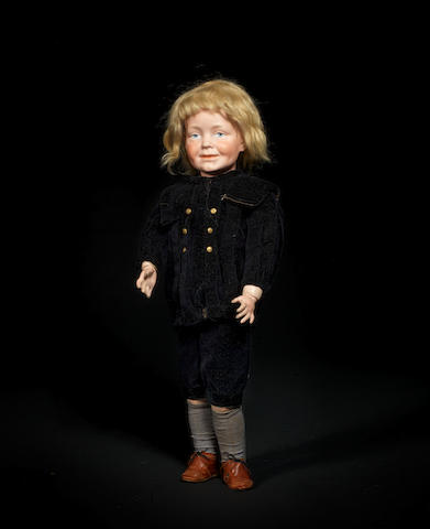 An extremely rare Kämmer & Reinhardt 104 bisque head character doll