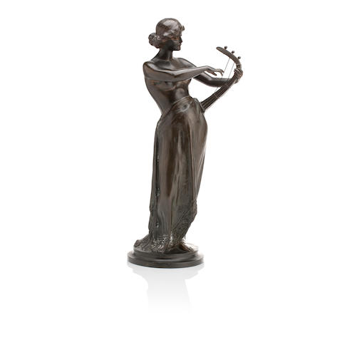 A bronze classical figure of a female harpist